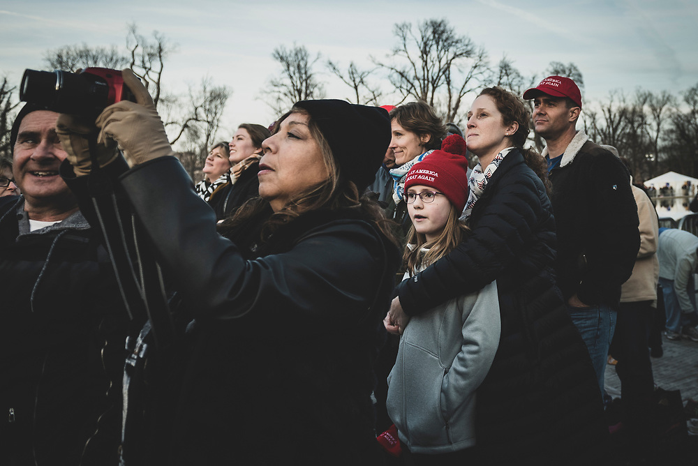 Supporters of President-elect Trump stand outside the Lincoln Memorial and listen to him speak on the eve of his inauguration.<br /> <br /> (Washington DC - January 19, 2017)