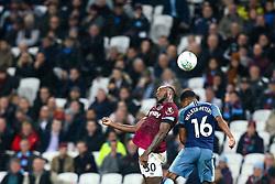 Michail Antonio of West Ham United challenges Kyle Walker-Peters of Tottenham Hotspur - Mandatory by-line: Robbie Stephenson/JMP - 31/10/2018 - FOOTBALL - London Stadium - London, England - West Ham United v Tottenham Hotspur - Carabao Cup
