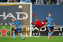 September 26, 2018 - Bronx, New York, US - Chicago Fire midfielder RAHEEM EDWARDS (7) jumps with a diving kick while defended by New York City FC defender ANTON TINNERHOLM (3) during a regular season match at Yankee Stadium in Bronx, New York.  New York City FC defeats Chicago Fire 2 to 0 (Credit Image: © Mark Smith/ZUMA Wire)