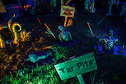 """Creatures struggle in tar pits in Chris Baker's haunted yard in South Yarmouth, MA. Every year Baker sets up an elaborate Halloween display in his yard and on Halloween, neighborohood residents walk through his frightening """"vortex"""" of horror while trick or treating."""