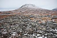 Rocky arctic terrain and autumn snow along Kungsleden trail, Lapland, Sweden