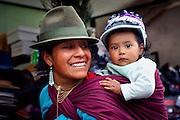 Quechuan Mother & Baby.Shopping For Hats At The Saquisili Market In Ecuador.