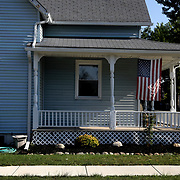 An American flag hangs from a Defiance Street home in Archbold, Ohio, on Wednesday, July 25, 2018. THE BLADE/KURT STEISS