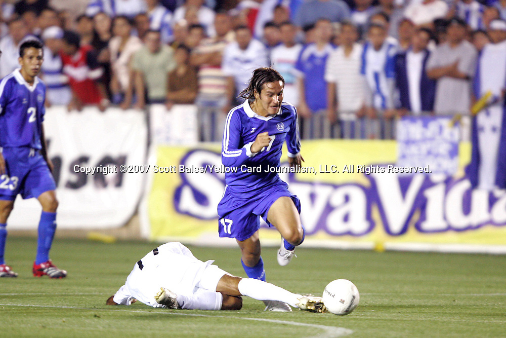 27 March 2007: El Salvador's Dennis Alas (17) dribbles past a fallen Honduras defender. The National Team of Honduras defeated the National Team of El Salvador 2-0 at SAS Stadium in Cary, North Carolina in an International Friendly soccer match.