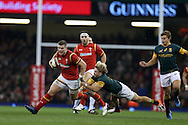 Scott Williams  of Wales breaks away from the tackle from Faf de Klerk of South Africa as he goes on the attack. Under Armour 2016 series international rugby, Wales v South Africa at the Principality Stadium in Cardiff , South Wales on Saturday 26th November 2016. pic by Andrew Orchard, Andrew Orchard sports photography