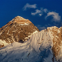 A sunset glows on the summit of Mount Everest in the Khumbu region of Nepal's Himalaya.