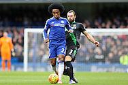 Willian of Chelsea is challenged by Erik Pieters of Stoke City. Barclays Premier league match, Chelsea v Stoke city at Stamford Bridge in London on Saturday 5th March 2016.<br /> pic by John Patrick Fletcher, Andrew Orchard sports photography.