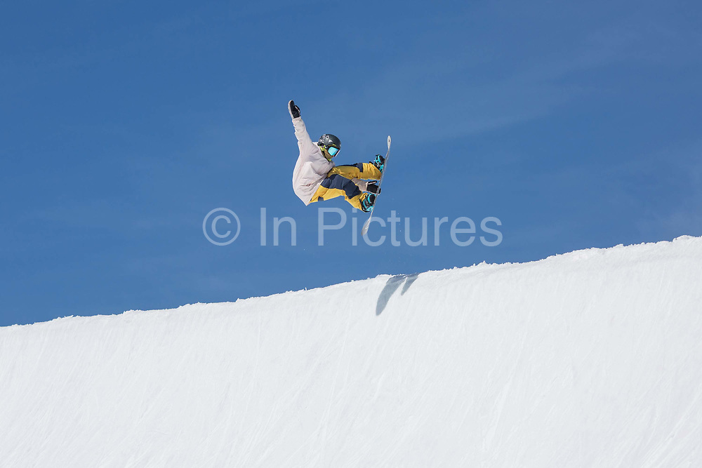 British female freestyle snowboarder Mia Brookes frontside air in the halfpipe on the 5th April 2019 in Laax ski resort in Switzerland. At 12 years old, Mia Brookes was recently selected to represent Great Britain in freestyle snowboarding.