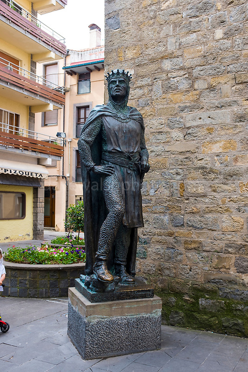 Statue of Ramiro I of Aragon (~1007-1063) by Ramón Casadevall, 1973. Torre del Reloj built in 1445, and has been a clocktower, a prison, and now the office of CTP - the Pyrenees Working Community, in Jaca, Huesca, Aragon, Spain