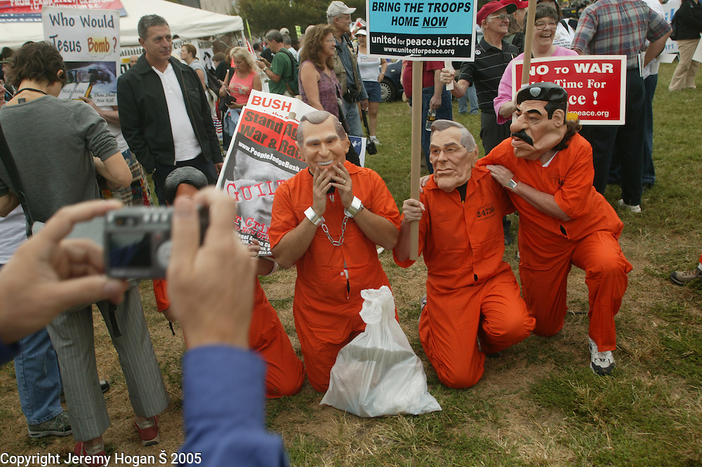Bush, Rumsfeld and Hussein impersonators are photographed during the anti-war march on Washington.