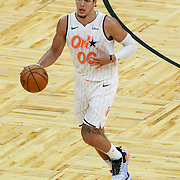 ORLANDO, FL - MARCH 24: Aaron Gordon #00 of the Orlando Magic dribbles the ball up the court against the Phoenix Suns during the second half at Amway Center on March 24, 2021 in Orlando, Florida. NOTE TO USER: User expressly acknowledges and agrees that, by downloading and or using this photograph, User is consenting to the terms and conditions of the Getty Images License Agreement. (Photo by Alex Menendez/Getty Images)*** Local Caption *** Aaron Gordon