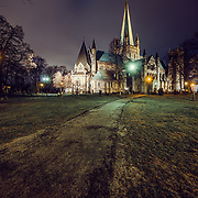 website: www.aziznasutiphotography.com                                <br /> King Olav Haraldsson was buried by Nidelven, the river Nid, after he was killed in the battle of Stiklestad in1030.<br /> <br /> Tradition has it that the high Altar of the Cathedral now stands on the exact spot of this burial site. One year and five days after he died the King was declared a saint, and pilgrims began to flock to Nidaros and the King's grave.<br /> <br /> The national sanctuary of Norway, built over the grave of St. Olav. Work began in 1070, but the oldest parts still in existence date from the middle of the twelfth century. These are in the Romanesque style, while most of the cathedral is Gothic in style. The building was completed in about 1300, but after being damaged several times by fire, it lay largely in ruins at the time of the Reformation in 1537. In 1869 extensive restorations were begun, and a century later it was again restored to its original grandeur. The stained glass dates from the early 20th century. The sculptures on the west front are by leading Norwegian artists, and the most recent was erected in 1983. Below the nave is the crypt with headstones from the middle ages. (From Trondheim.com)