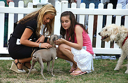 JADE JAGGER, her daugher AMBA and their dog Ella at the Macmillan Cancer Support Dog Day held in the gardens of the Royal Hospital, Chelsea, London on 4th July 2006.<br /><br />NON EXCLUSIVE - WORLD RIGHTS