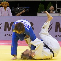 Official mascot (L) watches as Natsumi Tsunoda (in blue) of Japan and Charline Van Snick (in white) of Belgium fight during the Women -52 kg category at the Judo Grand Prix Budapest 2018 international judo tournament held in Budapest, Hungary on Aug. 10, 2018. ATTILA VOLGYI