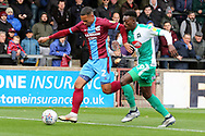 Scunthorpe United defender Jordan Clarke (2) and Plymouth Argyll forward Freddie Ladapo (19) chalenge for the ball  during the EFL Sky Bet League 1 match between Scunthorpe United and Plymouth Argyle at Glanford Park, Scunthorpe, England on 27 October 2018. Pic Mick Atkins