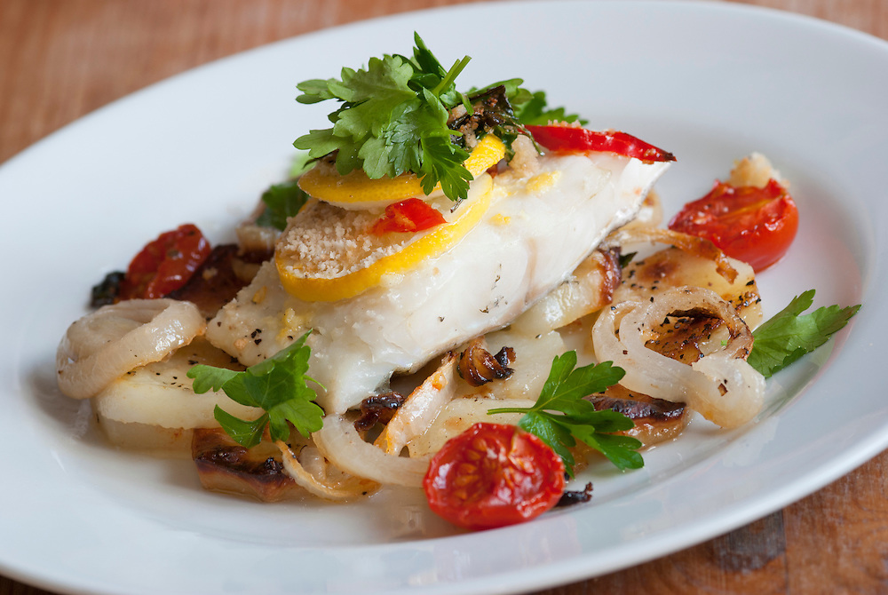 Baked cod with roast potatoes and vegetables