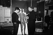"03/01/1967.01/03/1967.3rd January 1967.The third annual Aer Lingus Young Scientist Exhibition at the RDS..Padhraic Gearoid O Croibhin, Colaiste Iognaid Gaillimh, explains his exhibit ""The Human 'Telephone Exchange' The Nervous System Illustrated by Models' to Fr. PU O'Neill of the Christian Brothers School Mullingar ...."