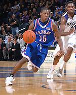 Kansas guard Mario Chalmers (15) drives past Kansas State guard Akeem Wright (34) in the first half at Bramlage Coliseum in Manhattan, Kansas, February 19, 2007.  Kansas defeated Kansas State 71-62.