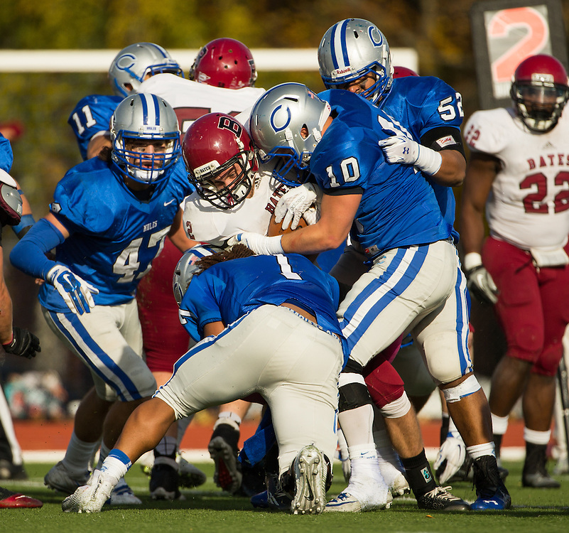 Bates College wide receiver Mike Decina (2) is stopped by  Colby College defensive lineman Ryan Ruiz (7) and linebacker Ryan Neville (10) during a NCAA Division III football game between Colby College and Bates College at Seaverns Field at Harold Alfond Stadium on October 24, 2015 in Waterville, Maine. (Dustin Satloff)