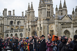© Licensed to London News Pictures. 31/03/2018. Cambridge, UK. Members of the public line the streets outside Kings College, for the funeral of Stephen Hawking at Church of St Mary the Great in Cambridge, Cambridgeshire. Professor Hawking, who was famous for ground-breaking work on singularities and black hole mechanics, suffered from motor neurone disease from the age of 21. He died at his Cambridge home in the morning of 14 March 2018, at the age of 76. Photo credit: Ben Cawthra/LNP