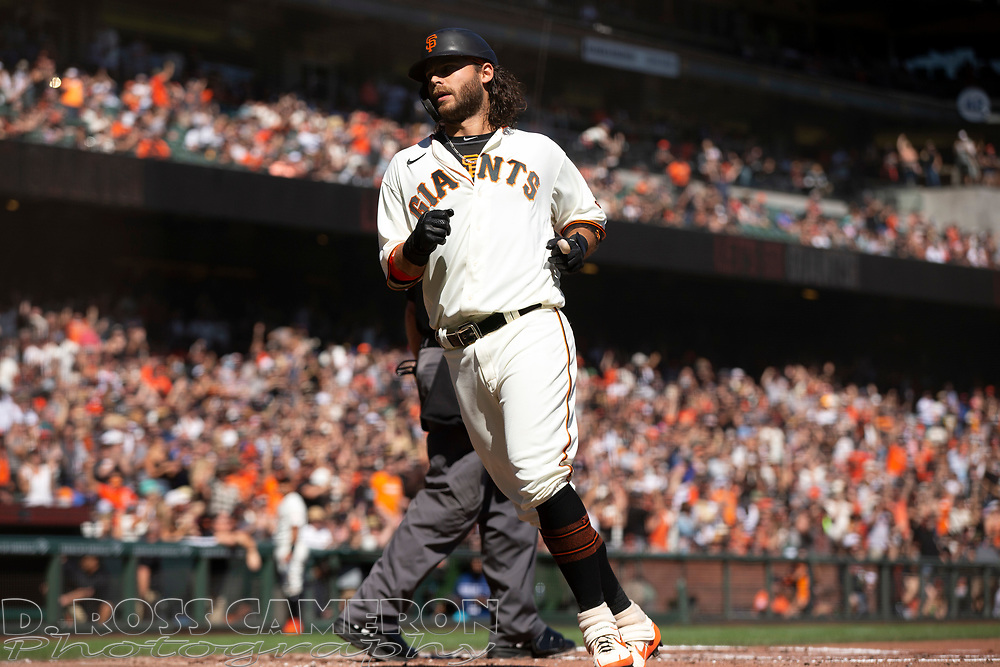 San Francisco Giants' Brandon Crawford (35) scores on Kris Bryant's single against the San Diego Padres during the second inning of a baseball game, Saturday, Oct. 2, 2021, in San Francisco. (AP Photo/D. Ross Cameron)