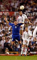 Photo. Jed Wee.<br /> England v Liechtenstein, European Championship Qualifier, Old Trafford, Manchester. 10/09/2003.<br /> England's Matthew Upson (R) heads clear from <br /> Liechtenstein's Fabio D'Elia.