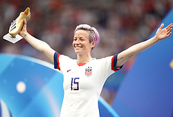 USA's Megan Rapinoe celebrates with the adidas Golden Boot after the final whistle
