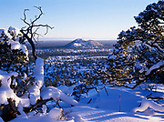Snow-covered El Malpais volcanic field viewed from rim of Bandera Crater, El Malpais National Monument, New Mexico.