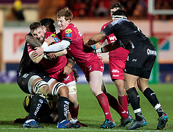 Scarlets' John Barclay is tackled by Toulon's Romain Taofifenua<br /> <br /> Photographer Simon King/Replay Images<br /> <br /> European Rugby Champions Cup Round 6 - Scarlets v Toulon - Saturday 20th January 2018 - Parc Y Scarlets - Llanelli<br /> <br /> World Copyright © Replay Images . All rights reserved. info@replayimages.co.uk - http://replayimages.co.uk
