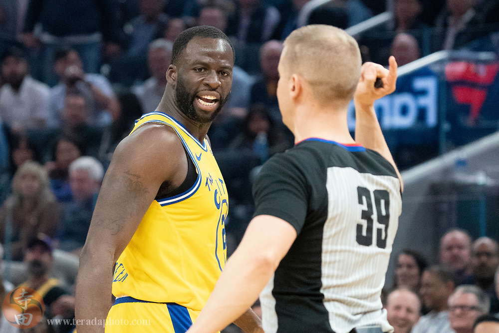 February 27, 2020; San Francisco, California, USA; Golden State Warriors forward Draymond Green (23) reacts after being ejected by NBA referee Tyler Ford (39) during the second quarter against the Los Angeles Lakers at Chase Center.