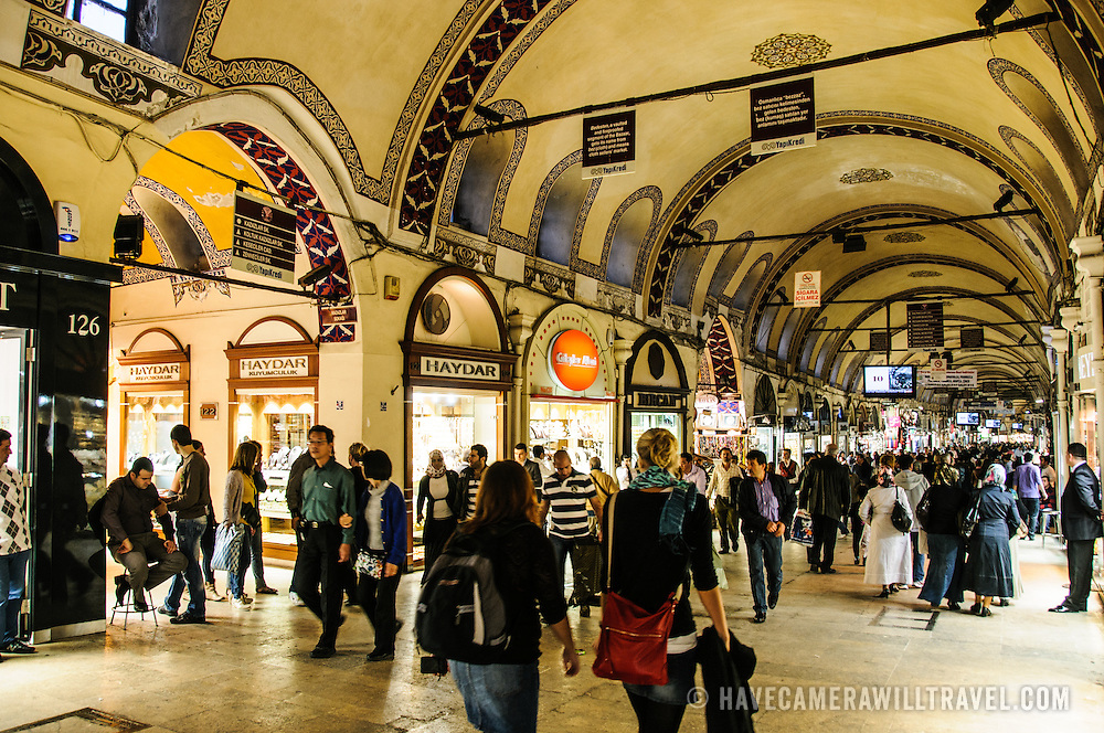 A busy street on the main strip of Istanbul's historic Grand Bazaar. The bazaar's streets are all covered, with the ceilings often ornately painted.
