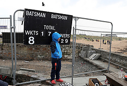 Embargoed to 0001 Monday August 28 Scores are kept during a match between the Ship Inn Cricket Club and the Eccentric Flamingoes Cricket Club on Sunday April 30th, 2017, in front of the pub in Elie, Fife, which is the only one in Britain to have a cricket team with a pitch on the beach. The Ship Inn Cricket Club season runs from May to September with dates of matches dependent on the tides. Any Batsman who hits a six which lands in the Ship Inn beer garden wins their height in beer and any spectator who catches a six in the beer garden also wins their height in beer.