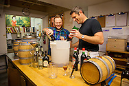 """Barrel-aged cocktails made by Clyde Common's restaurant bartender, Jeffery Morgenthaler, in Portland, Oregon.  Pictured here is Jeffery with his assistant, Junior Smith, preparing 2.5 gallons of """"Remember the Maine"""" - a classic cocktail named after the USS Maine which sank in the Havana harbor in 1898, the event which precipitated the Spanish-American War.  The drink consists of Rye Whiskey, Sweet Vermouth, Cheery Heering and Absinthe."""