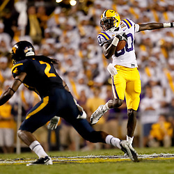 Sep 25, 2010; Baton Rouge, LA, USA; LSU Tigers wide receiver Terrence Toliver (80) catches a pass in front of West Virginia Mountaineers cornerback Robert Sands (2) during the second half at Tiger Stadium. LSU defeated West Virginia 20-14.  Mandatory Credit: Derick E. Hingle