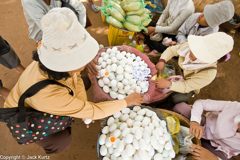26 JUNE 2006 - CENTRAL CAMBODIA: Women sell cooked eggs as a snack to travelers on Highway 6 between Phnom Penh and Siem Reap, Cambodia. PHOTO BY JACK KURTZ