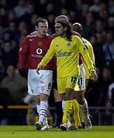 Photo: Jed Wee.<br /> Manchester United v Villarreal. UEFA Champions League.<br /> 22/11/2005.<br /> <br /> Manchester United's Wayne Rooney (L) has a go at Villarreal's Juan Pablo Sorin.