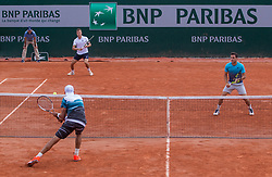 May 30, 2018 - Paris, Ile-de-France, France - Lukasz Kubot of Poland and Marcelo Melo of Brazil returns the ball to Márton Fucsovics of Hungary and Marco Cecchinato of Italy during the second round at Roland Garros Grand Slam Tournament - Day 4 on May 30, 2018 in Paris, France. (Credit Image: © Robert Szaniszlo/NurPhoto via ZUMA Press)