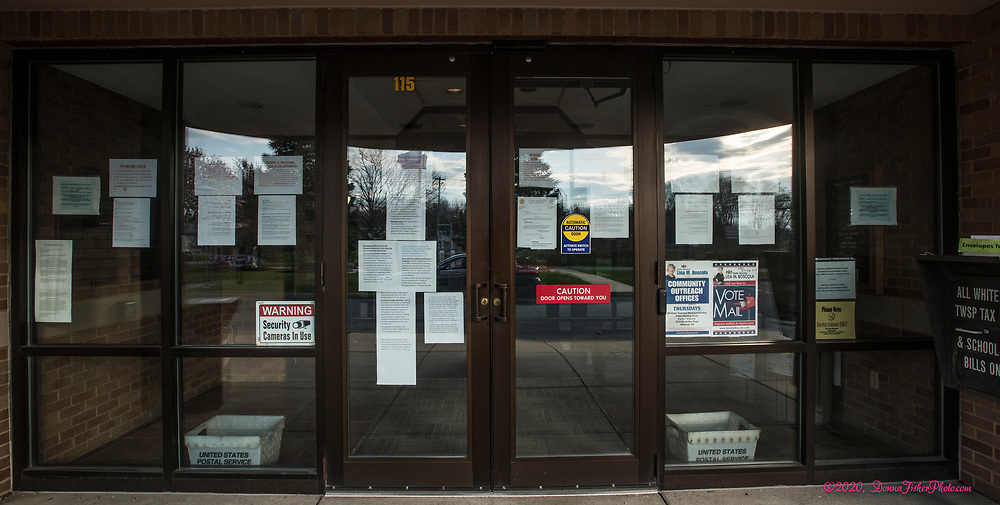 The front doors of the Whitehall Twp. Municipal Building are filled with notices due to coronavirus concern. Scenes along MacArthur Road in Whitehall Twp., Lehigh County, Pa.. Picture made April, 2020.<br />  Donna Fisher Photography, LLC