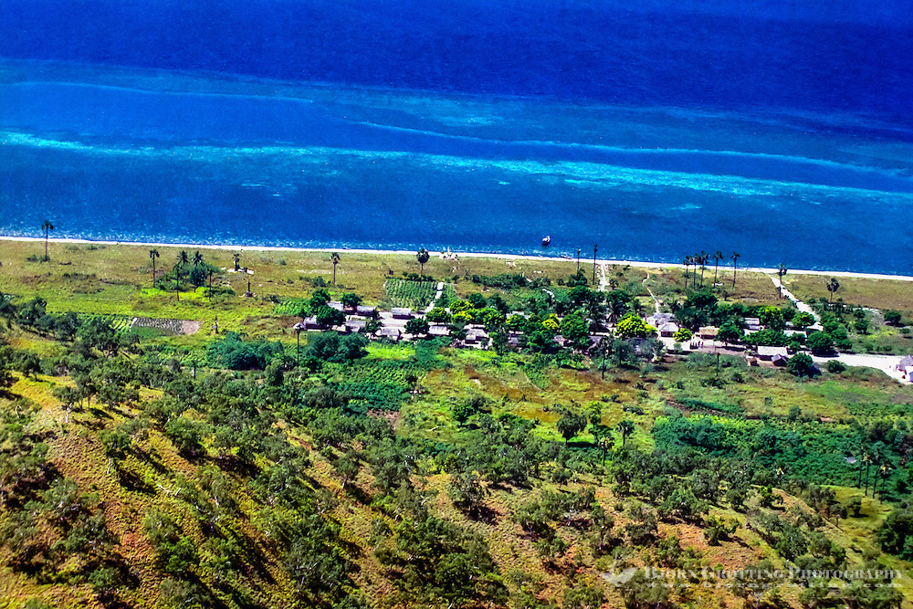 Maluku, South East Maluku, Pulau Liran. A small village on the southwest tip of Pulau Liran (from helicopter).