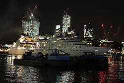 "© Licensed to London News Pictures. 17/09/2013. The last cruise ship to visit London in 2013 has departed the capital. ""Seabourn Pride"" transited through iconic Tower Bridge at 11pm on Monday night, marking the end of London's cruise ship season for 2013.  Passengers who boarded the 133 metre long vessel in London are beginning a 14 day cruise to Portugal. Six cruise ships have moored in the Upper Pool by HMS Belfast this year. Other ships visiting the Thames have used terminals at Greenwich and Tilbury, Essex. Credit : Rob Powell/LNP"