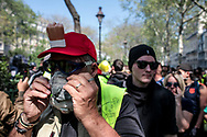 A protester is wearing a gas mask.