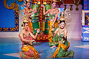 """Oct. 7, 2009 -- BANGKOK, THAILAND:  """"Ladyboys"""" perform on stage at the Mambo Cabaret in Bangkok, Thailand. The performers at the Mambo Cabaret in Bangkok, Thailand are all """"Ladyboys,"""" or kathoeys in Thai. Recognized as a third gender, between male and female, they are born biologically male but live their lives as women. Many kathoey realize they are third gender in their early teens, some only as old 12 or 13. Kathoeys frequently undergo gender reassignment surgery to become women. Being a kathoey in Thailand does not carry the same negative connotation that being a transgendered person in the West does. A number of prominent Thai entertainers are kathoeys. Photo by Jack Kurtz / ZUMA Press"""