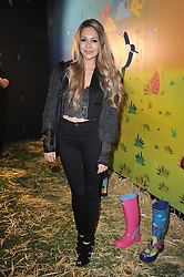 ZARA MARTIN at a party to celebrate the global launch of the Iconic Brazilian lifestyle brand Havaianas Wellies range held at Selfridges, Oxford Street, London on 14th April 2011.