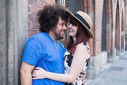 Happy young couple embracing outdoors in city