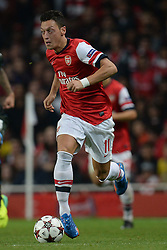 LONDON, ENGLAND - Oct 01: Arsenal's midfielder Mesut Ozil from Germany   during the UEFA Champions League match between Arsenal from England and Napoli from Italy played at The Emirates Stadium, on October 01, 2013 in London, England. (Photo by Mitchell Gunn/ESPA)