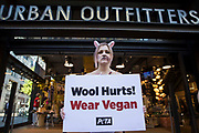 A PETA supporter dressed as a bloodied sheep protests outside a branch of Urban Outfitters in Oxford Street to call for an end to wool sales on 21st October 2021 in London, United Kingdom. The protest forms part of an international PETA campaign to urge Urban Outfitters Inc brands including Anthropologie and Free People to stop selling materials cruelly taken from animals.