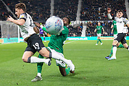 Moses Odubajo (22) gets the ball away from Chris Martin (19) during the EFL Sky Bet Championship match between Derby County and Sheffield Wednesday at the Pride Park, Derby, England on 11 December 2019.