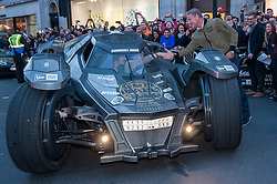 © Licensed to London News Pictures. 02/05/2016. London, UK. Ex Formula 1 driver, David Coulthard, welcomes a Lamborghini with a £2m makeover to make it look like the Batmobile, at the finish line. Large crowds come to Regent Street to see the arrivals of supercars in the Gumball 3000 race.  Supercars race from Dublin to Bucharest, stopping at major cities en route including London. Photo credit : Stephen Chung/LNP