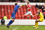 Burton Albion goalkeeper Stephen Bywater (1) punches the ball hitting Nottingham Forest forward Jason Cummings (35) in the face during the EFL Sky Bet Championship match between Nottingham Forest and Burton Albion at the City Ground, Nottingham, England on 21 October 2017. Photo by Jon Hobley.