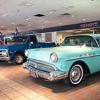 A 1971 GMC Sierra truck and a 1957 Buick Century inside the showroom at Rico Auto Complex, photographed Wednesday, June 5 in Gallup to celebrate their 100 year anniversary.